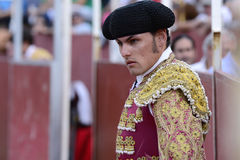 Bullfighter. Torero in the square next to the wall, with his cap placed on the head Stock Image