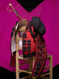 Bullfighter. On a wooden chair, and in the background the cape Royalty Free Stock Photo