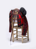 Bullfighter. On a wooden chair, and the sword in the center Royalty Free Stock Image