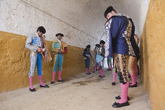 Bullfighters getting dressed for the paseillo or initial parade Stock Image