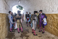 Bullfighters speaking on the alley waiting to come out to the bu Royalty Free Stock Photography