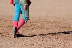 Bullfighting walking on the sand with his sword Stock Images