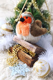 Bullfinch and Christmas-tree decorations Royalty Free Stock Image