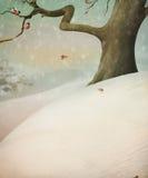 Bullfinch dos que se sienta en un árbol. Árbol en la nieve. Imagenes de archivo