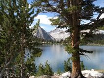 Bullfrog Lake framed. Bullfrog Lake is in the Sierra Nevada Mountains of California. When approaching the John Muir Trail from the eastern Sierra, a popular royalty free stock photos