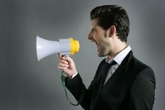 Bullhorn businessman megaphone profile shouting. Loud Royalty Free Stock Image