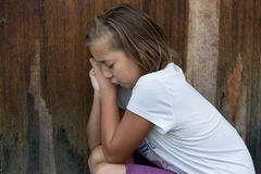 Bullied girl child cry in front of door alone Royalty Free Stock Photography