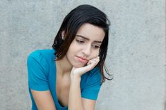 Bullied latin american young adult woman. Outdoors with copy space stock photos