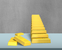 Bullion stacking in stairs shape on desk Royalty Free Stock Image