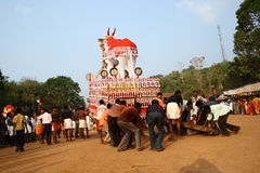 Bullock effigy. Effigy of huge bullock is driven by people in a temple festival procession in Kerala, India Royalty Free Stock Photos
