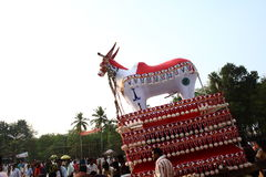Bullock effigy. Huge effigy of bullock is being driven by people in a temple festival procession in Kerala, India Royalty Free Stock Image