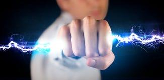Bullone della luce di elettricità della tenuta dell'uomo di affari in sue mani Fotografie Stock Libere da Diritti