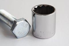 Bullone e zoccolo metrici Fotografie Stock