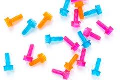Bulloni di plastica traslucidi al neon colorati del giocattolo su fondo bianco Disposizione piana Il giorno del papà del mondo di fotografie stock