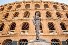 Valencia city in Spain. Bullring building with toreador monument in Valencia city in Spain Royalty Free Stock Images