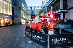 Bullring during Chinese New Year, Birmingham - 16 Feb 2018. To celebrate the Chinese New Year 2018, the iconic bull in front of the Birmingham Bullring shopping Royalty Free Stock Image
