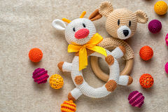 Bulls and bears. Educational concept of sand pit bulls and bears in the financial market. crocheted rattle cow and bear  children`s toys among colorful beads Stock Photography