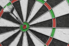 Bulls eye. Single dart in the bulls eye on a dart board Stock Photos