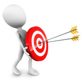 Bulls eye. Bulls-eye or hitting the target with accuracy, man figure holding the target with arrows hitting the center, red target, white background Royalty Free Stock Images