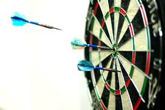 Bulls Eye. A dart player trying to do a bulls eye while playing dart Stock Photos