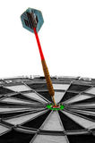 Bulls eye. Dart hitting a bulls-eye on white background Stock Image