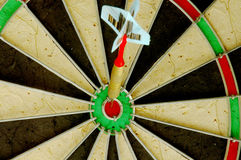 Bulls-eye. Dart hitting a bulls-eye royalty free stock images