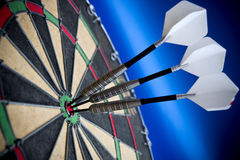 Bulls eye. Three darts in the bulls eye Royalty Free Stock Photography