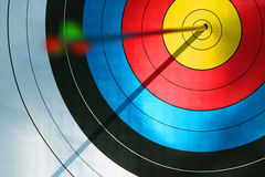 Bulls eye (archery). Close up of bulls eye with blured arrow's feather Stock Photos