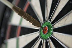 Bulls eye. Close up of dart hitting bulls eye on dart board Stock Photos