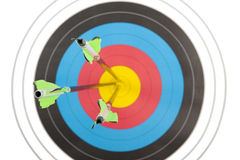 Bulls eye hit by three arrows Stock Images