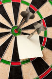 Bulls-eye and note. Pair of darts with successful bulls-eye and a blank square memo note Stock Images