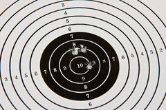 Bulls-eye target with bullet holes Royalty Free Stock Image