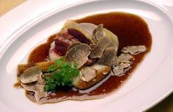 Bulls testicles in truffle sauce  Stock Photos
