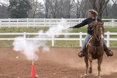 Bullseye at 50 MPH. Woman partisipating in mounted shooting equestrian sport Royalty Free Stock Photos