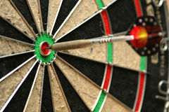 Bullseye. Dart smack in the middle of a bullseye Royalty Free Stock Photography