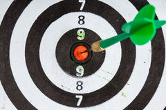 Bullseye. Black and white target with dart as sport background Royalty Free Stock Images