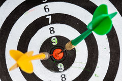 Bullseye. Black and white target with darts as sport background Royalty Free Stock Photos