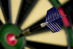 Bullseye dart on dartboard