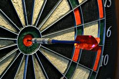 Bullseye dart on dartboard stock images