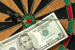 Bullseye and dollars. Concept of having business success by throwing darts Stock Image