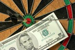 Bullseye and dollars Stock Image