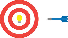 Bullseye with light bub and dart Stock Photography