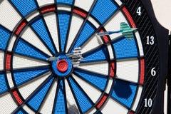 Bullseye success. Darts game hitting bullseye as an success and business iconic image Stock Image