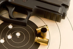 Bullseye target and gun royalty free stock photo