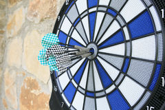Bullseye on a wall with some darts.  royalty free stock photo
