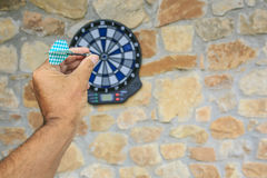 Bullseye on a wall with some darts Stock Images