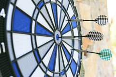 Bullseye on a wall with some darts Stock Photography