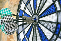 Bullseye on a wall with some darts Royalty Free Stock Photos