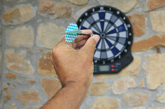 Bullseye on a wall with some darts Royalty Free Stock Photography