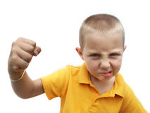 Bully. Ing child wanting to fight waving with his fist Royalty Free Stock Images